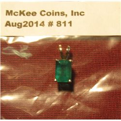 811.  LARGE, deep cut emerald mounted in 14K white gold. Marked 14K on side of bale