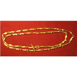813.   Gold filled watch chain, marked MONET