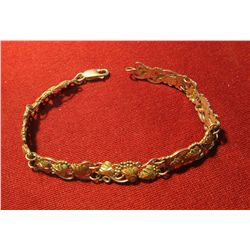 818. Sterling bracelet from Black Hills Gold in South Dakota – marked 925 and 12K, has yellow and ro