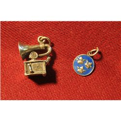820. 2 silver charms – old style Victrola record player (marked STER) and an enameled charm with 3 c