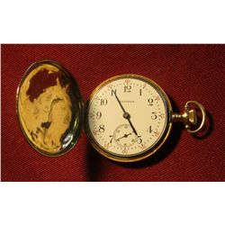 828. 14K Waltham pocket watch, case is marked 14K 0.585 FINE GUARANTEED. Winds, runs, keeps time. We