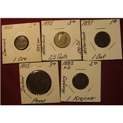 1590. 1885 KB Hungary 1 Krajczar; 1805 Ireland Penny; 1897 Netherlands 1c holed; 1895 Netherlands 25