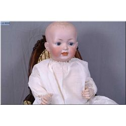 "24"" German Hertel and Schwab bisque head baby doll marked 14, with fixed glass eyes, on composition"