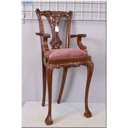 "Carved dark wood doll's high chair with upholstered seat 34"" in height"