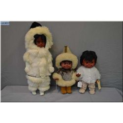 "Two 12"" vintage Regal Kimmie dolls including one in rabbit skin costume and a 20"" Inuit style doll w"