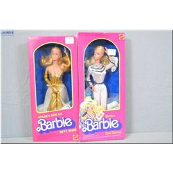 Two vintage new in package Barbie dolls including Western Barbie winking Barbie doll with autograph