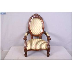 "Doll sized balloon back chair with carved back and legs and upholstered seat, arms and back 23"" in h"