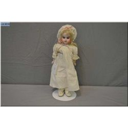 "Cabinet sized 12"" Huebach Kopplesdorf bisque shoulder head doll with bisque arms on a kid leather bo"