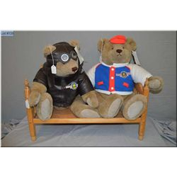 Two large limited edition Bialosky bears by Gund including Aviator and baseball player on a wooden d