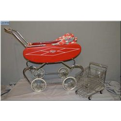 Child's vintage Gendron doll buggy with red painted steel body and checkered bonnet and a steel doll