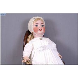 "Beautiful and rare 27"" Cuno & Otto Dressel baby doll on composition body with blue green glass eyes,"