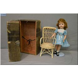 "14"" hard plastic doll with open mouth, sleep eyes and saran hair in original outfit, a woven wicker"
