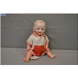 "9"" bisque head German doll on composition baby body with painted hair, set blue glass eyes, great bi"