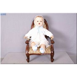 "20"" baby doll with composition head, arms and legs on stuffed body, sleep eyes, molded hair and open"