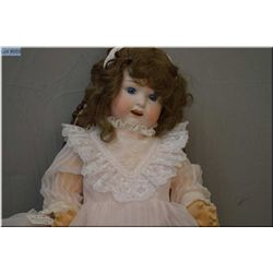 "27"" Huebach Kopplesdorf baby doll marked 267.8 with bisque head, set glass eyes, open mouth, on comp"