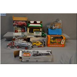 Selection of boxed toys including an Ertl Fordson tractor, 1926 Mac tanker, Texaco tanker, Volkswage
