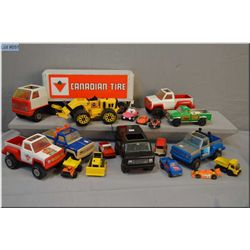 Selection of toys including Tonka vans and trucks, Canadian Tire tractor trailer etc.