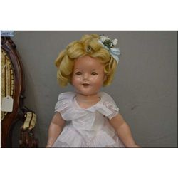 "18"" Ideal Shirley Temple composition doll in excellent condition with original onesie and tagged dre"