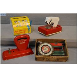 Selection of vintage tin toys including Marx Arithmetic toy, a Sew-ette sewing machine, a Simplex ty