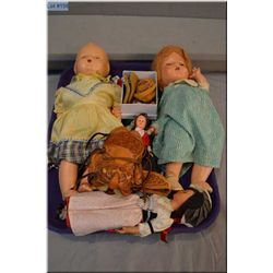 Selection of vintage and composition dolls, small leather saddle, moccasins etc.