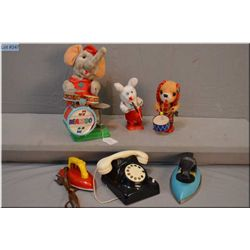 Selection of vintage toys including two irons, telephone, two wind-up bears and battery operated Ele
