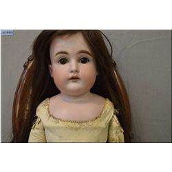 "25"" German bisque 147 -11- doll on leather body with sleep eyes, open mouth on leather body, good bi"