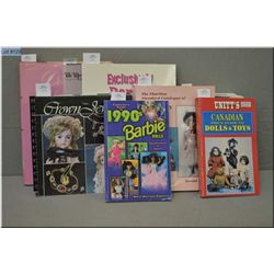 Selection of soft and hard cover doll reference guides including Barbie, Canadian dolls, blue books