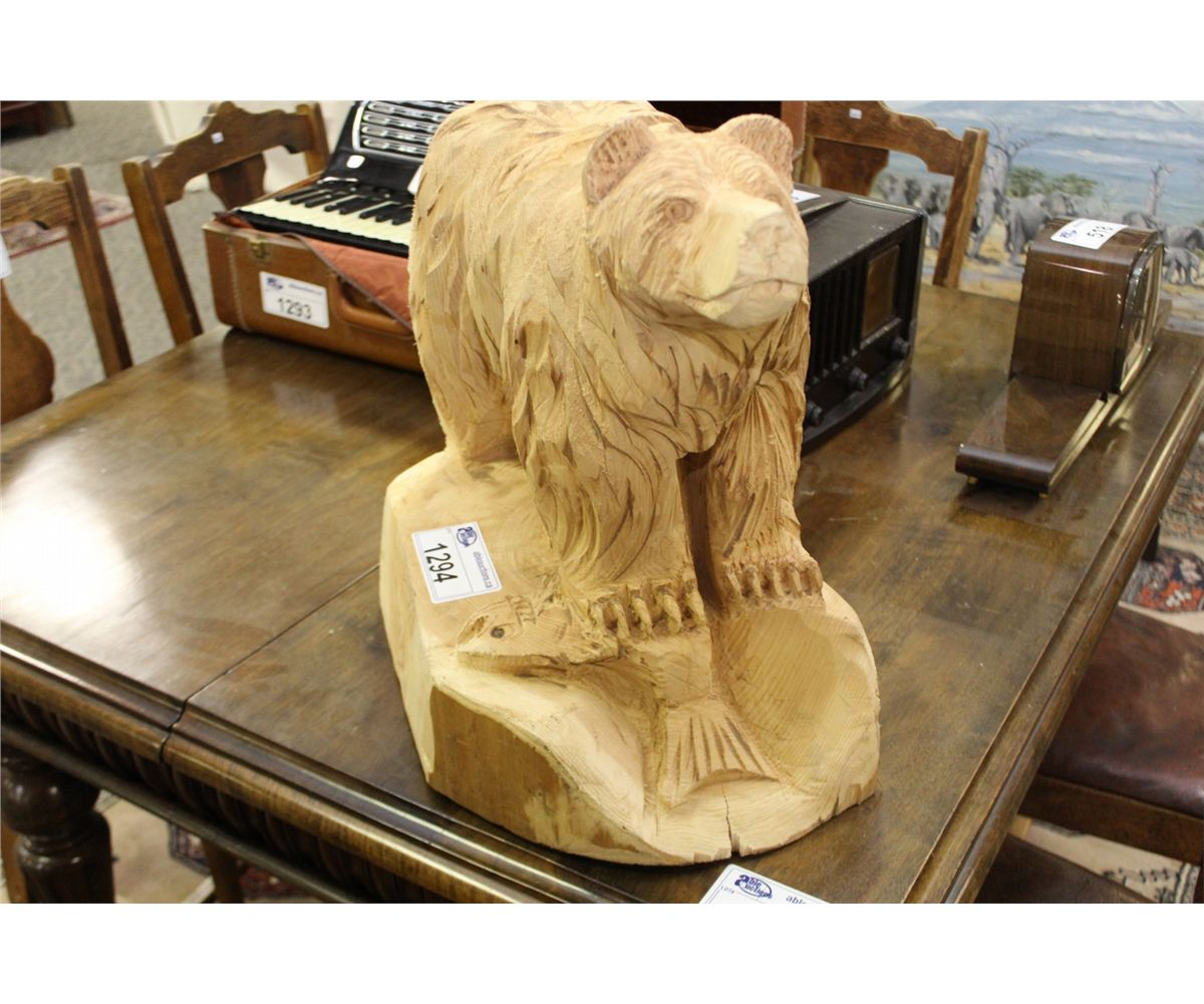Chainsaw carving of bear with fish