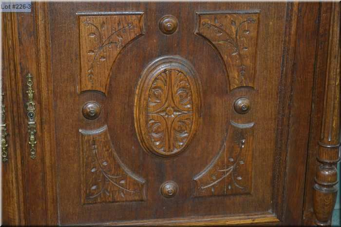 Antique Carved Oak Court Cabinet With Multiple Raised Panel Doors