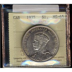 Dollar 1935 ICCS MS-65 with light toning. Not mentionned is Doubling on Indian & Voyageur.