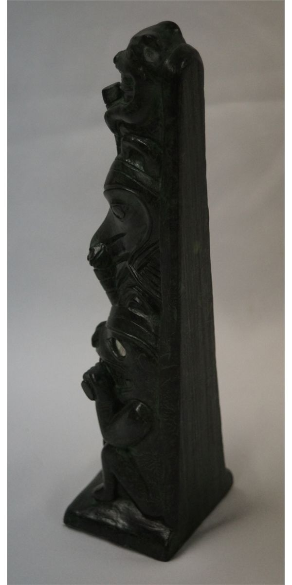 Canadian inuit carved totem pole by greg wolf