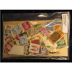 908. Large hoard of mostly Cancelled U.S. & Great Britain Postage Stamps.