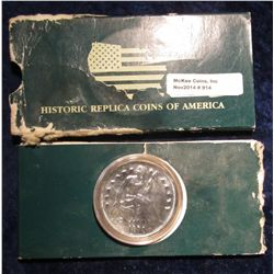 914. 1873 S Seated Liberty Dollar Replica encapsulated and in holder.