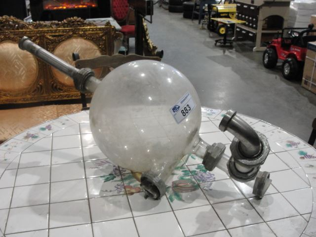 large glass ball accessory to vintage milking machine. Black Bedroom Furniture Sets. Home Design Ideas