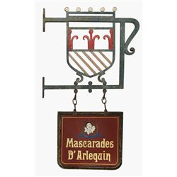 Wrought iron hanging store sign for Mascaraded D Arlequin.