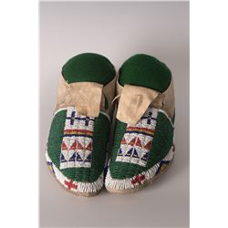 "Northern Plains Moccasins, 10"" long."