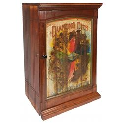 "Country store cabinet, Diamond Dye, ""Evolution of Woman"", colorful litho on embossed tin front panel"