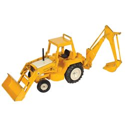 "Toy backhoe, International (IH), mfg by Ertl, dark yellow w/white rims, Exc cond, 25""L when extended"