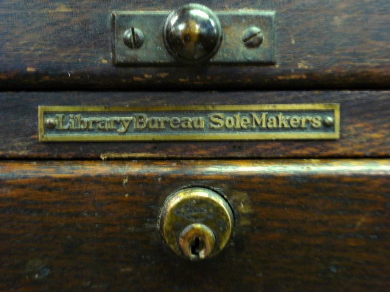 Vintage oak four drawer file cabinet with a brass label on front ...