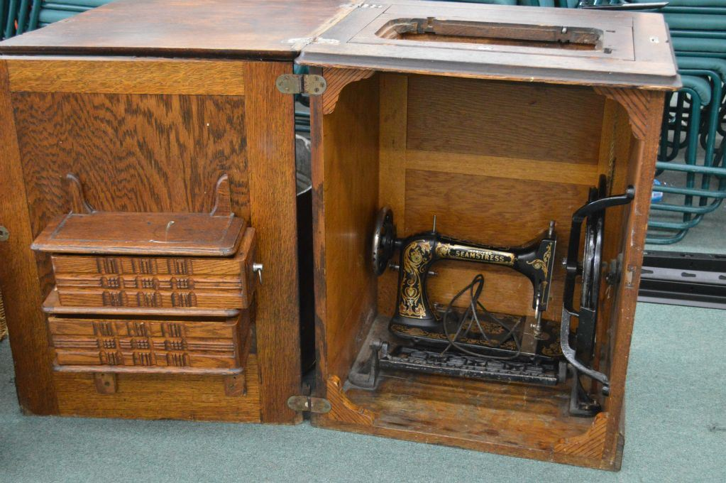 ... Image 2 : Antique Oak Sewing Cabinet With Cast Metal Antique Seamstress  Sewing Machine And A