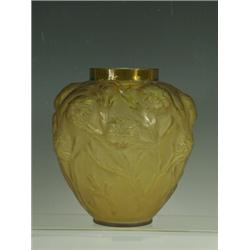 A Sabino amber glass vase moulded with flowering foliage, etched mark to base 'Sabino France' 19c...