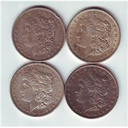 USA Silver dollar 1879, 1880O, 1882O & 1921 in VF to AU. Lot of 4 coins.