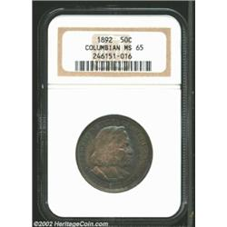 1892 50C Columbian MS65 NGC. Deep shades of gently mixing blues and grays dance above their lustrous