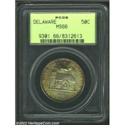 1936 50C Delaware MS66 PCGS. Medium to deep shades of earthen-gold and charcoal-gray patina loiter a