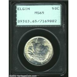 1936 50C Elgin MS65 PCGS. The luster grazes that account for the grade are hidden in the details of.