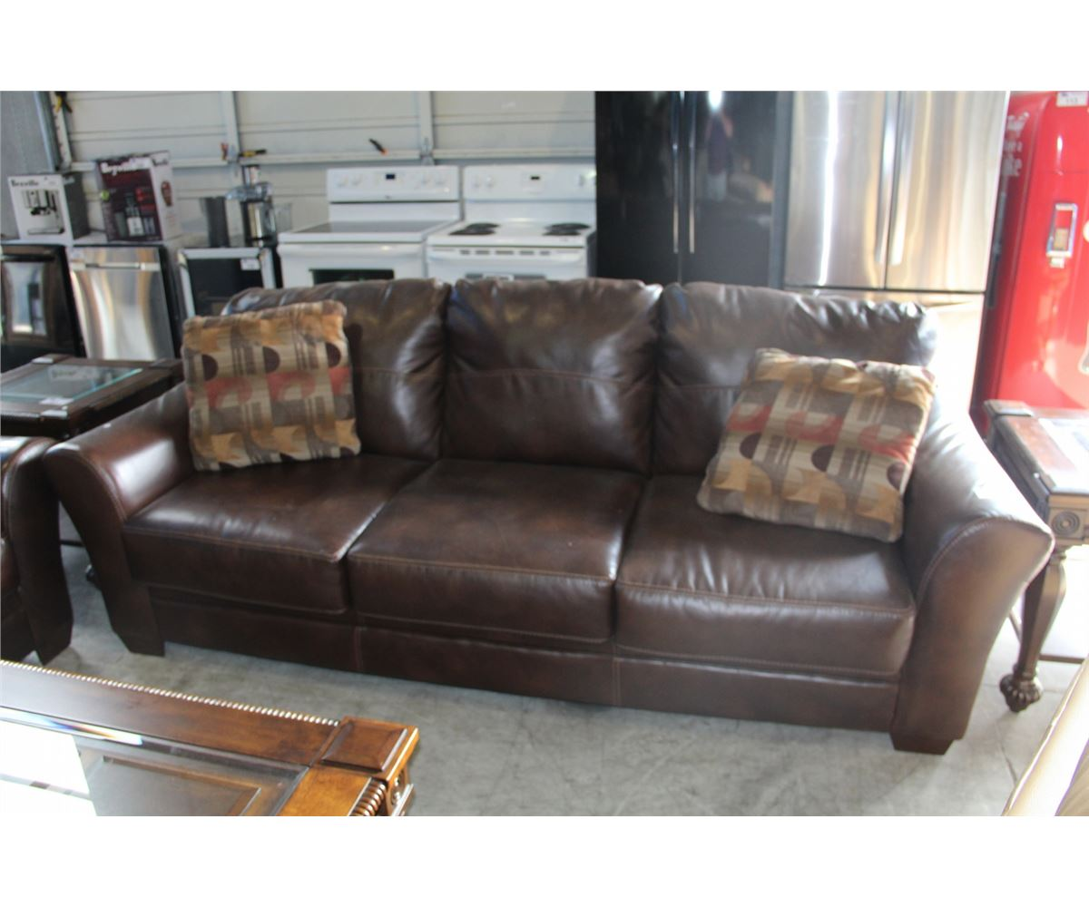 Brown leather sofa with 2 throw cushions able auctions Leather sofa throws