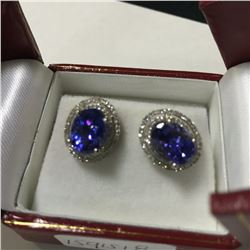 ONE PAIR OF 14KT YELLOW GOLD AND RHODIUM FINISH NATURAL TANZANITE AND DIAMOND SET EARRINGS WITH 140