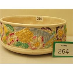 Clarice Cliff bowl with embossed floral and bird decoration, 9  diameter