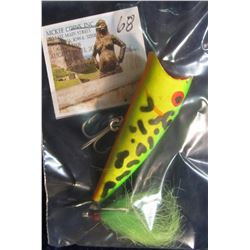 68. Hula Popper Style Lure with dual blade spinning prop, dual treble hooks, and a Chartreuse tail.