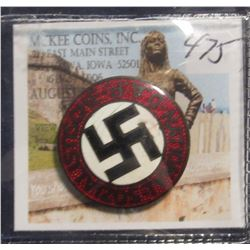 "475. ""National Sozialistische D.A.P."" World War II. Depicts Swastika with red and black enamel."